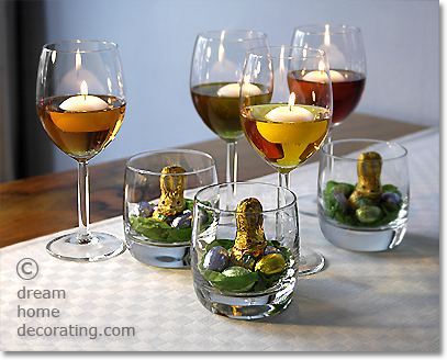 Easter table lights: Centerpieces made of floating candles and mini nests in glass tumblers