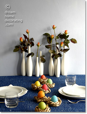 Easter dinner table decoration with kraft-paper Easter nests