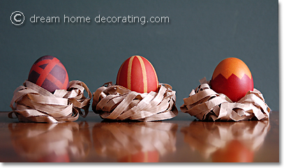 pattern-dyed brown easter eggs in paper nests