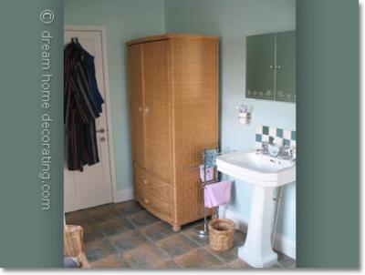 Mint bathroom walls with old washstand & wicker cupboard