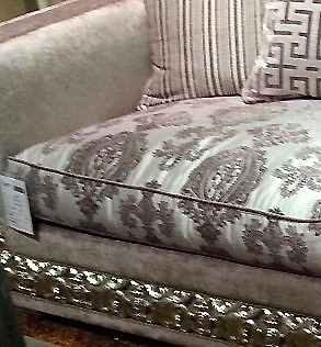 Silver-framed sofa with light greyish purple upholstery fabric