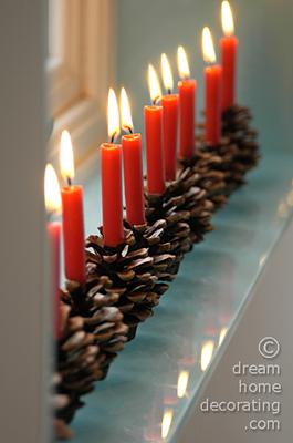 Windowsill decoration with pine cone candle holders