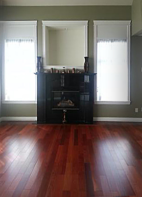 Open-plan living & dining room with cherrywood color flooring