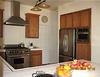AFTER: New cooker & hood, fridge & cupboard doors