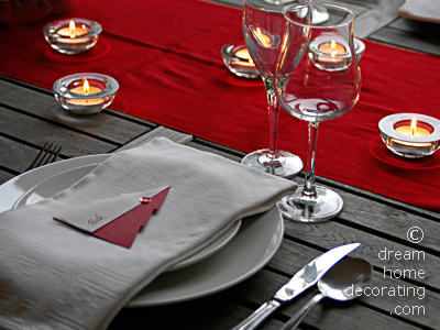 Christmas table setting in silver, white, grey and red